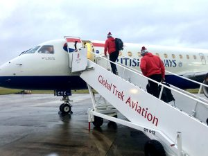 Professional rugby team boarding aircraft for travel to European competition fixture