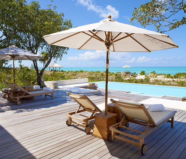 COMO Parrot Cay, Turks & Caicos sunbeds by pool