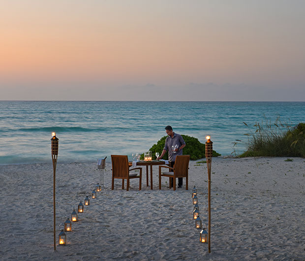 COMO Parrot Cay, Turks & Caicos candle lit path to beach dining