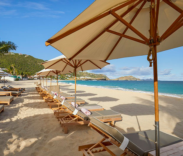CHEVAL BLANC ST-BARTH ISLE DE FRANCE, ST BARTHS line of sunbeds on the beach