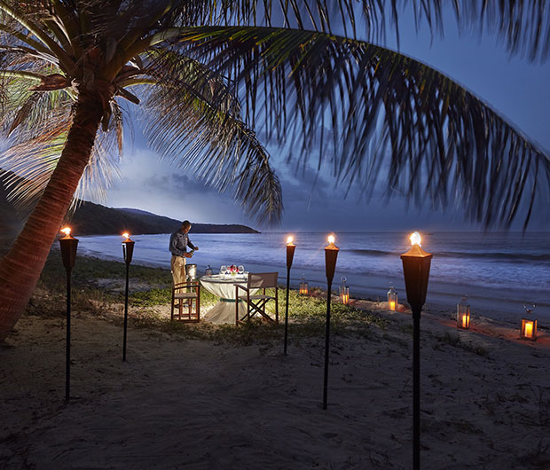 MANDARIN ORIENTAL CANOUAN, ST VINCENT & THE GRENADINES candle lit path to beach dining