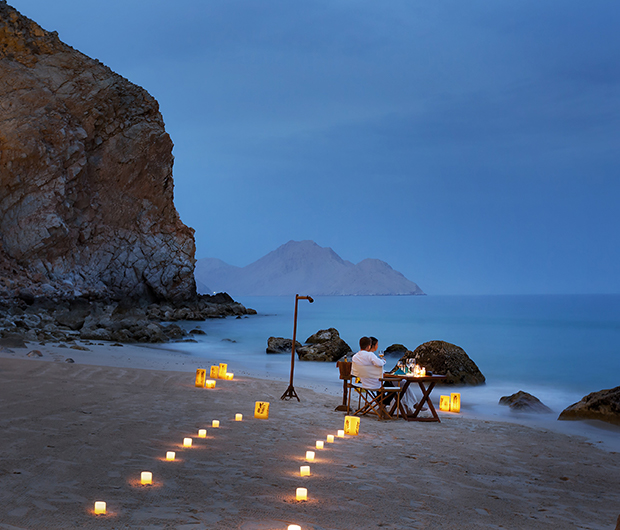 SIX SENSES ZIGHY BAY, OMAN candle lit path to beach seating