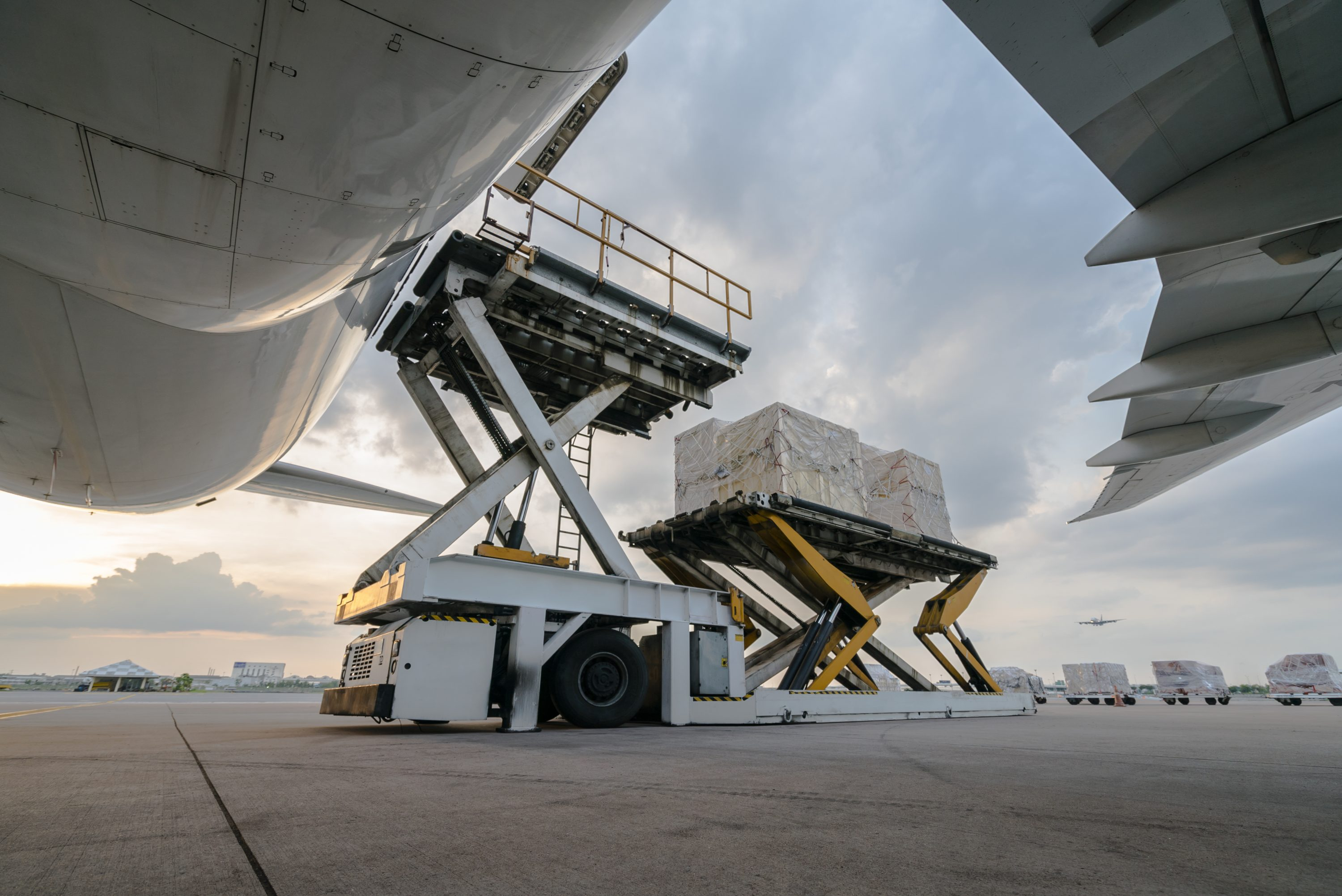 Cargo being loaded onto aircraft with scissor lift